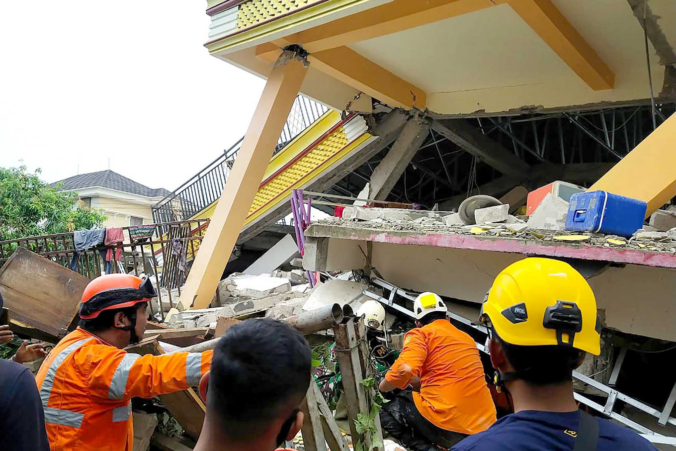 At least three dead as buildings collapse in West Sulawesi quake