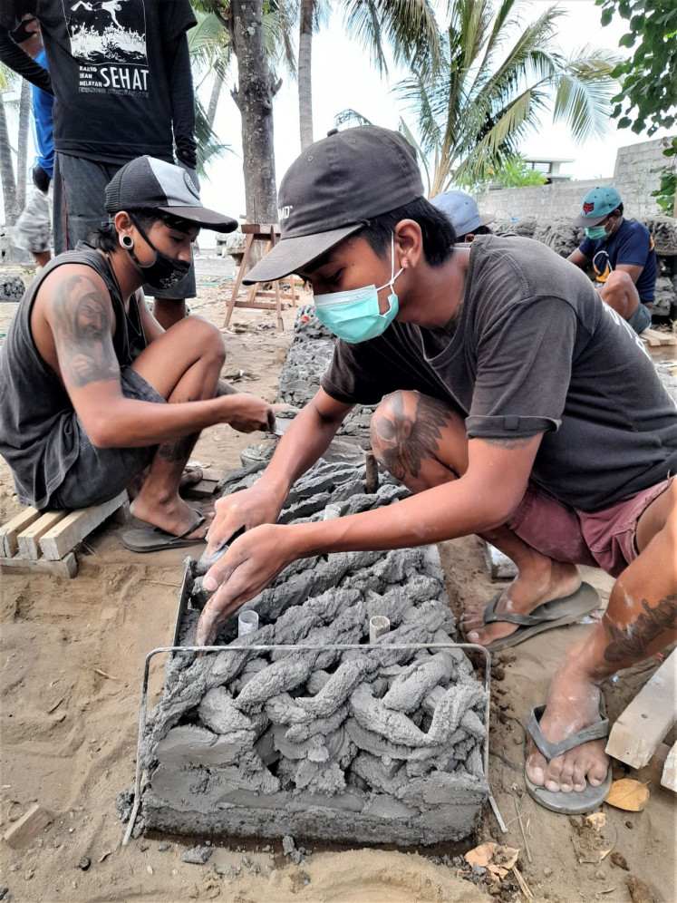 Work in progress: Young people from local communities in Bali build artificial structures for new coral reefs to be grown.