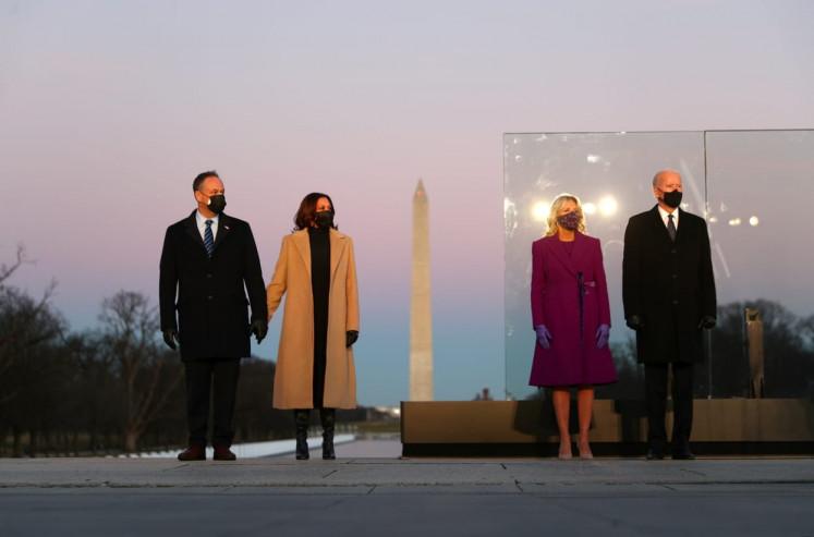 US President-elect JoeBiden, his wife JillBiden, Vice President-elect Kamala Harris and her husband Doug Emhoff attend a coronavirus disease (COVID-19) memorial event at the Lincoln Memorial in Washington, US. January 19, 2021.