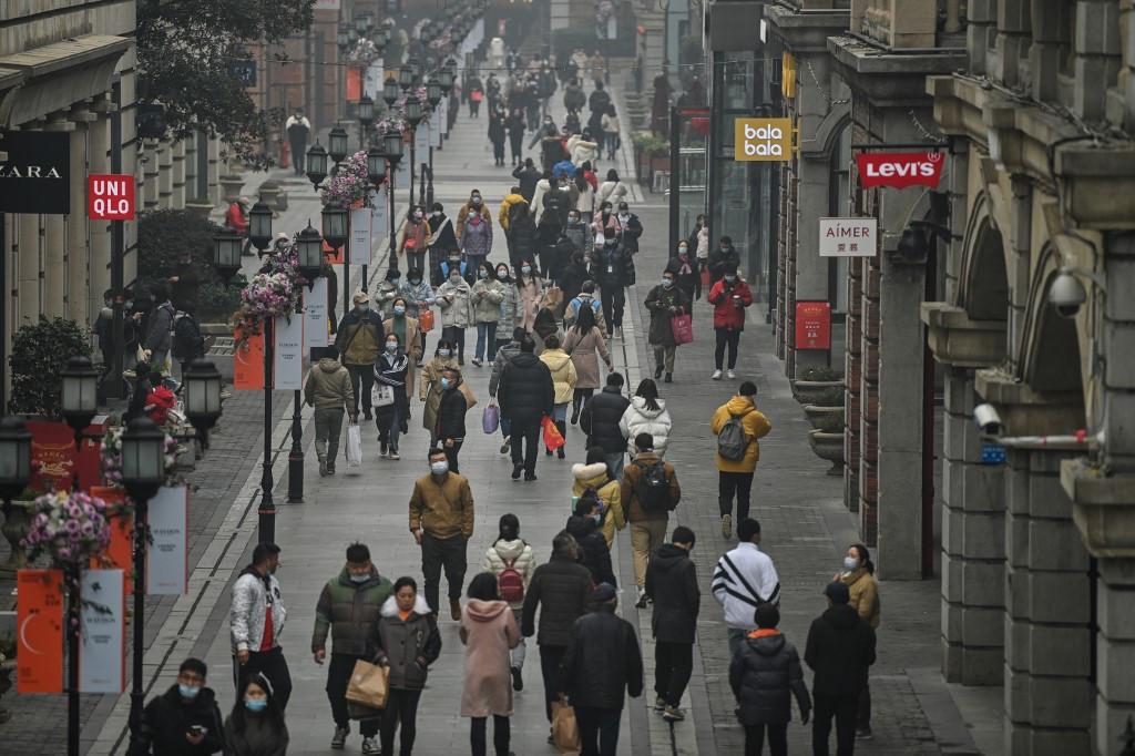 Wuhan marks a year since lockdown as Biden warns of 600,000 dead