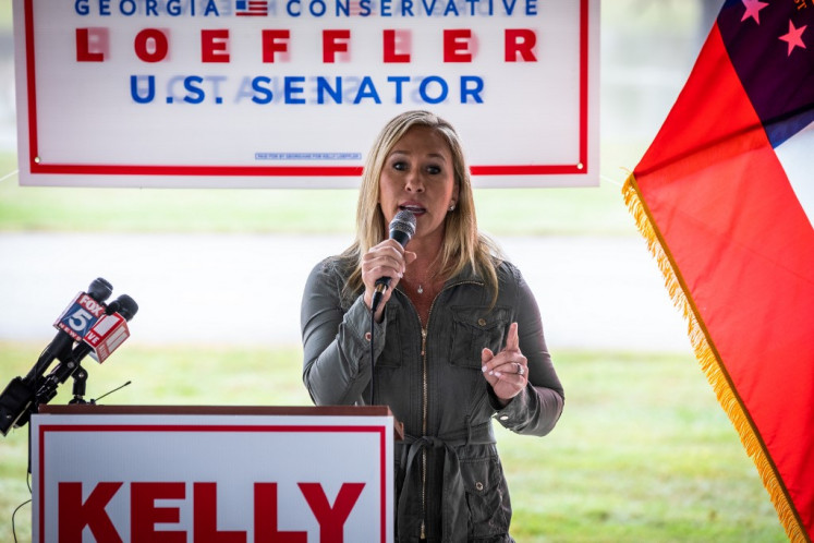 Georgia Republican House candidate Marjorie Taylor Greene endorses Sen. Kelly Loeffler (R-GA) during a press conference on October 15, 2020 in Dallas, Georgia. Greene has been the subject of some controversy recently due to her support for the right-wing conspiracy group QAnon.