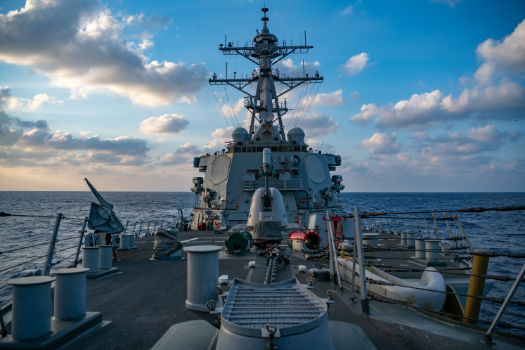 This US Navy photo released April 29, 2020 shows The Arleigh-Burke class guided-missile destroyer USS Barry (DDG 52) conducting underway operations on April 28, 2020 in the South China Sea. Barry is forward-deployed to the US 7th Fleet area of operations in support of security and stability in the Indo-Pacific region. A US Navy guided-missile destroyer sailed through waters near the Paracel islands in the South China Sea challenging China's claim to the area, the Navy said April 29, 2020. The USS Barry undertook the so-called