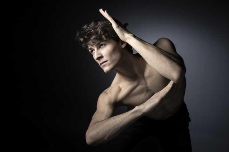 French dancer Hugo Marchand poses during a photo session in Paris on March 7, 2019. He has just released a book,