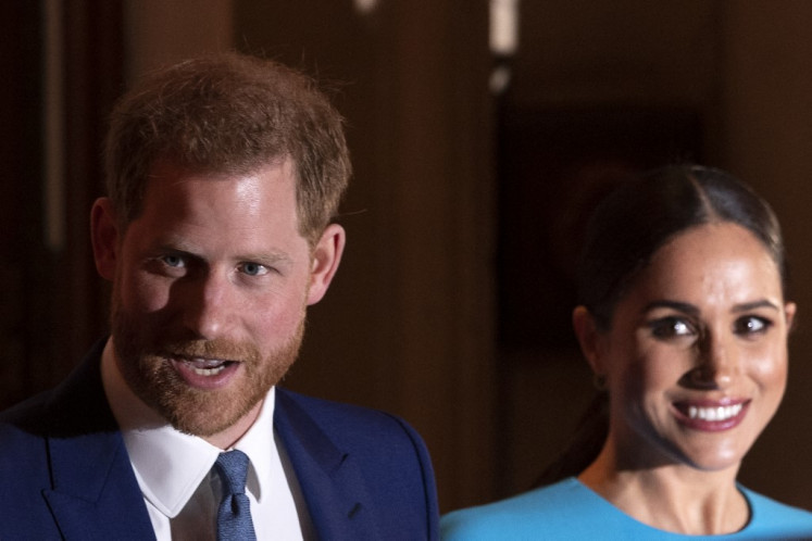 Britain's Prince Harry, Duke of Sussex (L), and Meghan, Duchess of Sussex seen here leaving the Endeavour Fund Awards at Mansion House in London in March of last year. They have launched a number of legal cases against news outlets alleging invasion of privacy, including over paparazzi shots of their son Archie.