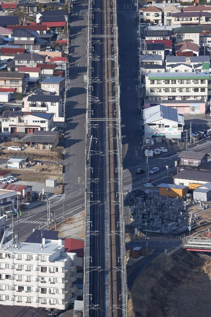 This aerial picture taken from a Jiji Press chartered aircraft shows the Tohoku Shinkansen track with tilted pillars supporting the overhead line in Koriyama, Fukushima prefecture on February 14, 2021 after a 7.3-magnitude earthquake struck off Japan's east coast late on February 13.