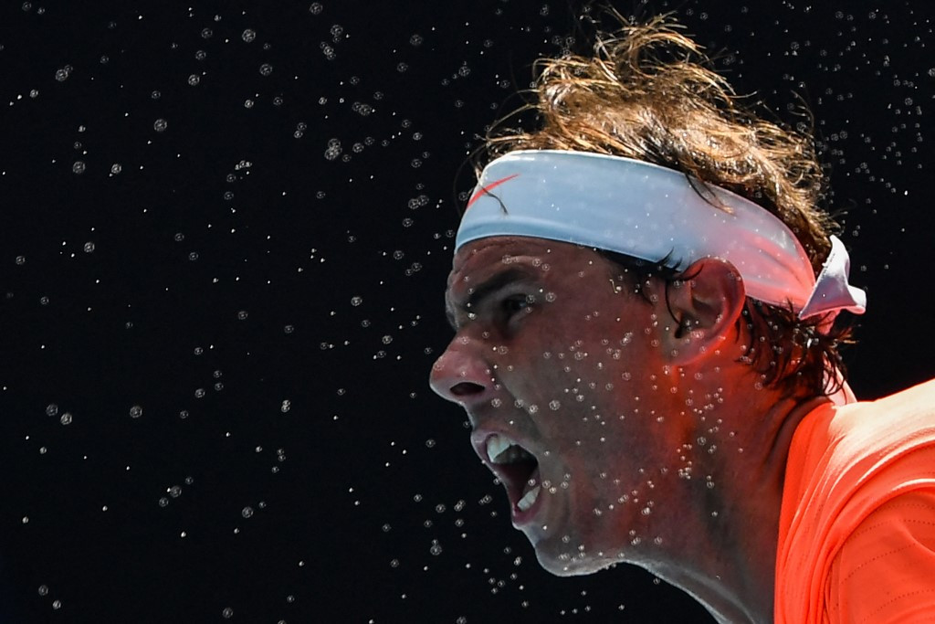 Nadal crushes fiery Fognini to reach quarter-finals