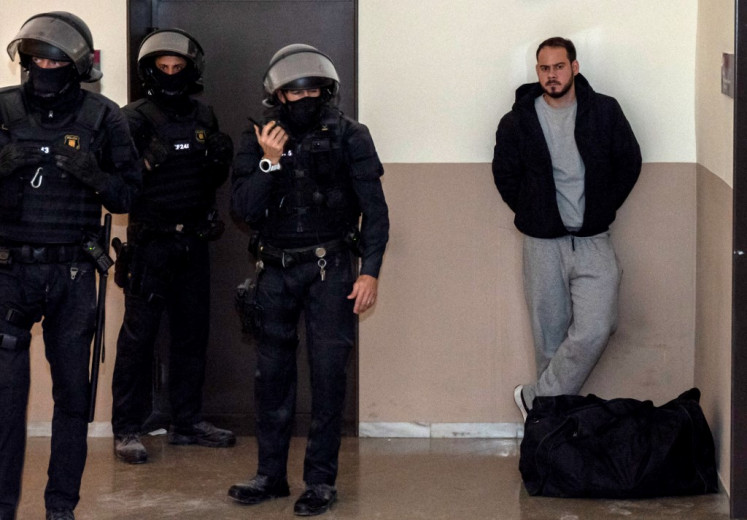 Catalan rapper Pablo Hasel (right) is arrested by police at the University of Lleida, 150 kms (90 miles) west of Barcelona, on February 16, 2021 where he had barricaded himself. Spanish police today arrested a rapper who barricaded himself inside a university after he was controversially sentenced to nine months in jail over a string of tweets, television images showed. Pablo Hasel had been given until the night of February 12 to turn himself in to begin serving his sentence after being convicted for glorifying terrorism, slander and libel against the crown and state institutions.