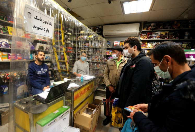 A vendor sells games and consoles to customers at a shop in the central market of Iran's capital Tehran. Iran's millions-strong legion of gamers revel in online worlds, but they have to fight daily real-life obstacles imposed by US sanctions in their quest to level up and keep playing.