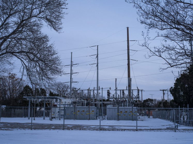 An Oncor power substation is surrounded by snow in Waco, Texas, on February 18, 2021. A deadly winter weather system that brought record-busting cold to the southern and central United States, knocking out power for millions in oil-rich Texas, blanketed the East Coast in snow February 18, 2021, disrupting coronavirus vaccinations.