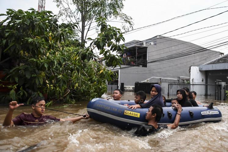 Thousands evacuated, traffic disrupted as floods hit Jakarta at rainy season peak