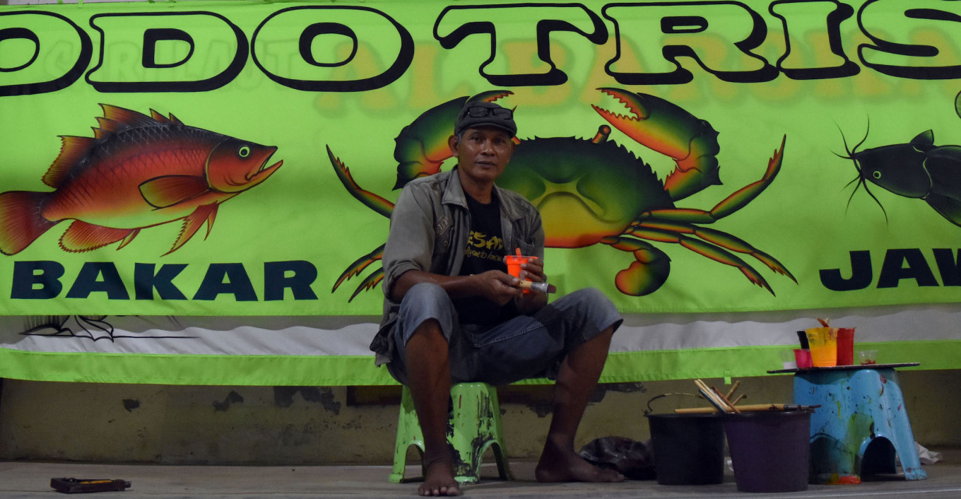The painter behind 'pecel lele' banners