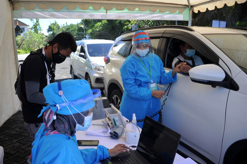 [INSIGHT] Overcoming COVID-19 vaccine hesitancy - The Jakarta Post - Jakarta Post