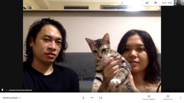 "Aga and Tomo sought the help of an ""animal communicator"" to learn more about their cat."