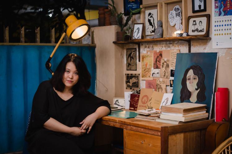 Artist Candrika Soewarno at her desk.