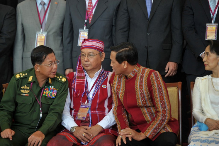 (Left-right) Myanmar military commander in chief Senior General Min Aung Hlaing, speaker of upper house of parliament Mahn Win Khaing Than and Vice President Henry Van Thio speak next to Myanmar State Counsellor and Foreign Minister Aung San Suu Kyi after the opening ceremony of the peace conference in Naypyidaw on August 31, 2016.