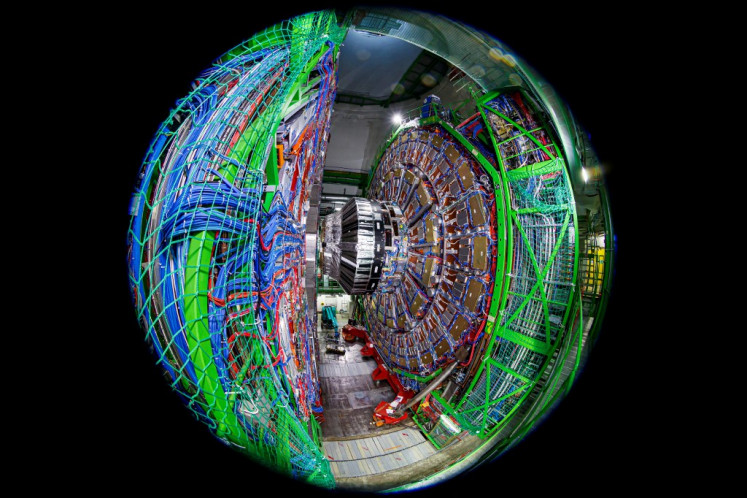 A picture taken on February 6, 2020 with a fish-eye lens shows the Compact Muon Solenoid (CMS) detector assembly in a tunnel of the Large Hadron Collider (LHC) at the European Organisation for Nuclear Research (CERN), during maintenance works in Cessy, France, near Geneva.