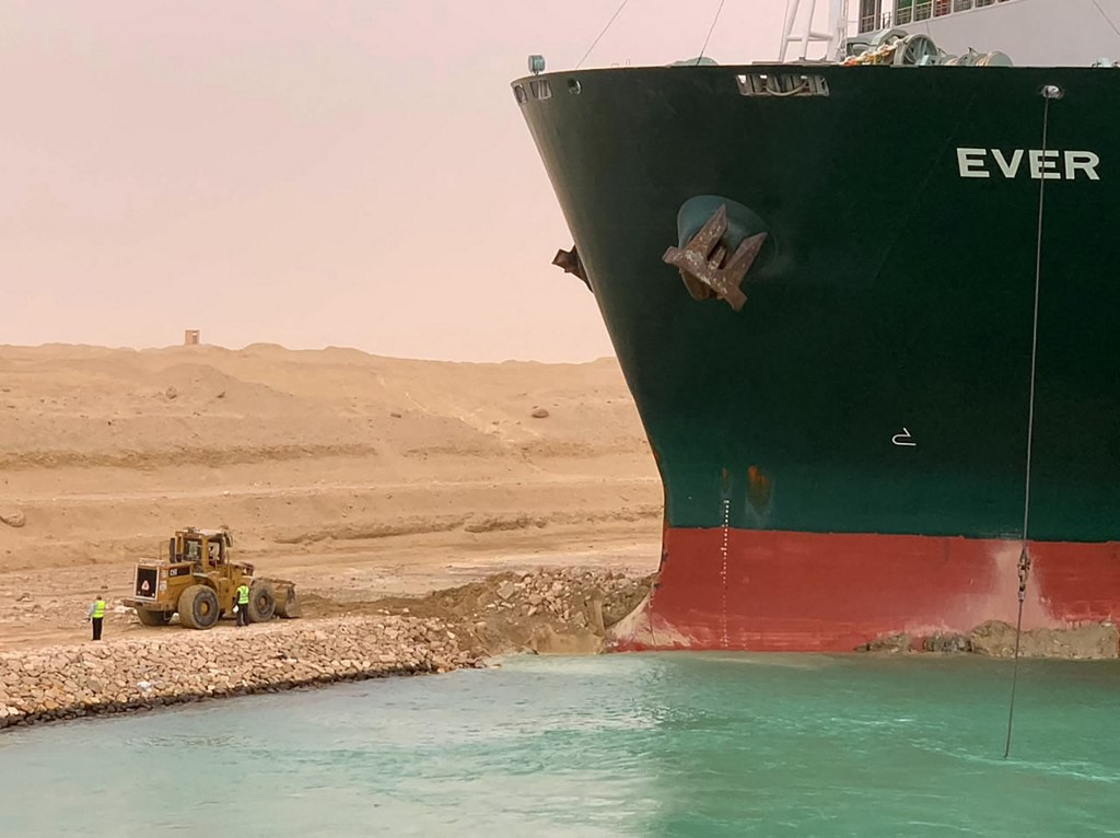 Japanese owner faces 'extreme difficulty' refloating ship stuck in Suez Canal