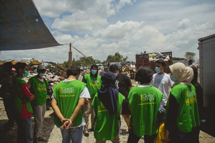 Members of Garda Pangan prepare before distributing food items.