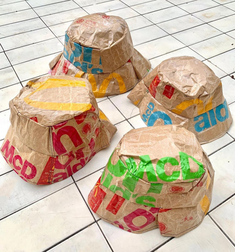 Bucket caps are made from scrap paper bags from fast food chains.