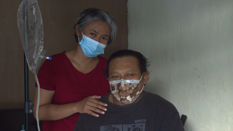 Christina Windarwati and her husband Stefanus Meilarius. He says he appreciates the sacrifices she has made in taking care of him.