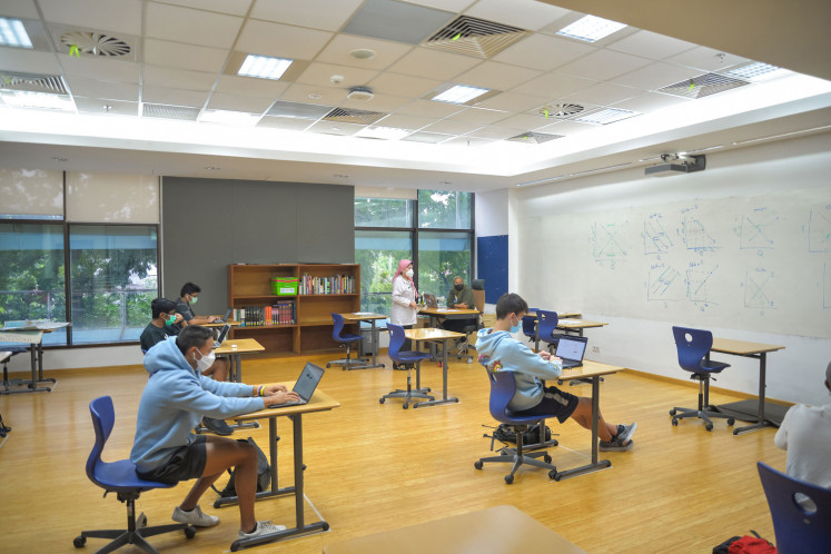 Students return to learning inside a classroom at the JIS campus, with blended learning applied under instructions from the Education and Culture Ministry and the Jakarta Education Agency.