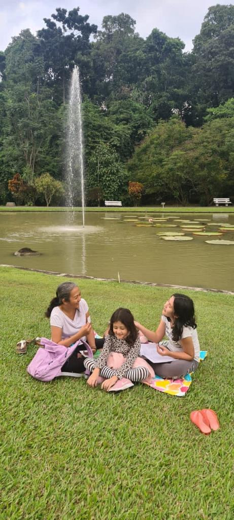 Maria (left) spends some quality time outdoors with her daughters, Senja (center) and Tala.