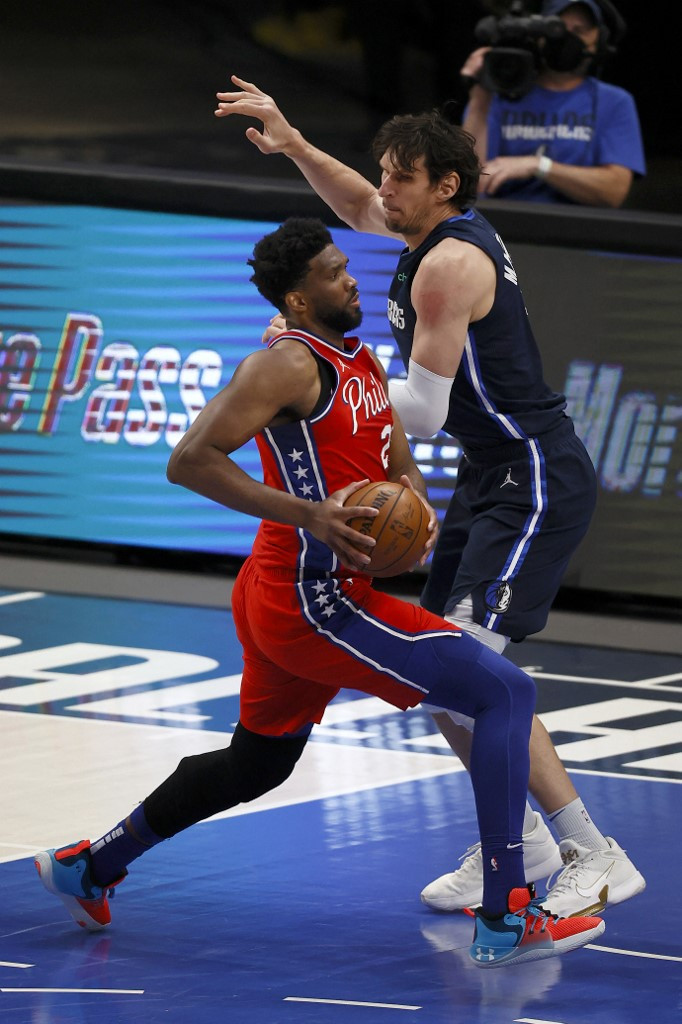 Joel Embiid #21 of the Philadelphia 76ers drives to the basket against Boban Marjanovic #51 of the Dallas Mavericks in the first half at American Airlines Center on April 12, 2021 in Dallas, Texas.