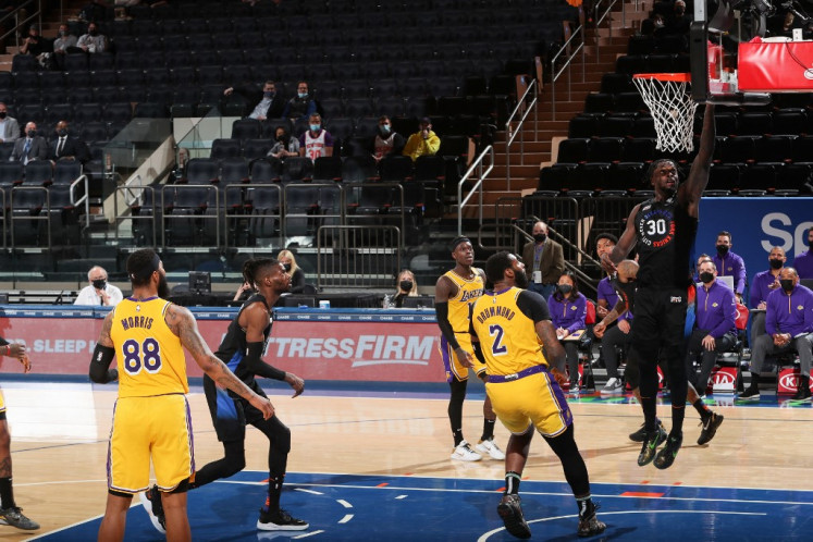 Julius Randle #30 of the New York Knicks drives to the basket during the game against the Los Angeles Lakers on April 12, 2021 at Madison Square Garden in New York City, New York.