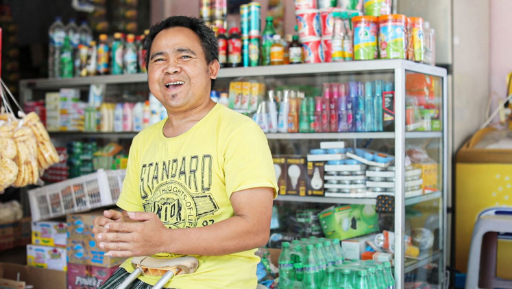 Cahyo Widodo, a disabled agent partner of GrabKios in Salatiga, is now financially independent.