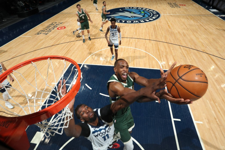 Khris Middleton #22 of the Milwaukee Bucks drives to the basket during the game against the Minnesota Timberwolves on April 14, 2021 at Target Center in Minneapolis, Minnesota.