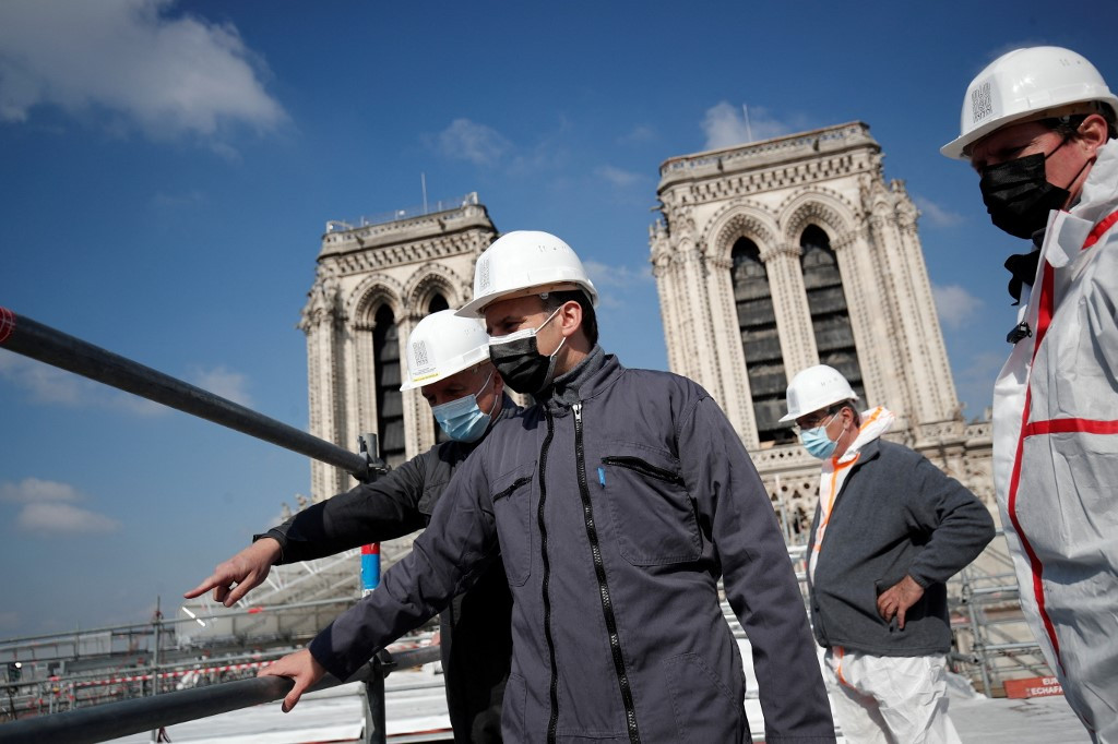 Macron scales Notre-Dame's rooftop two years after cathedral fire