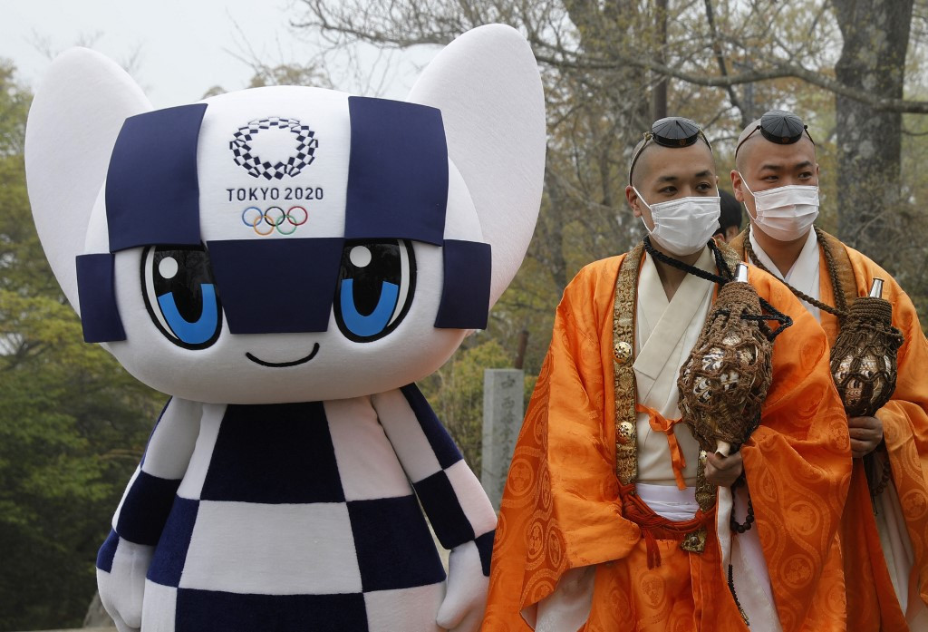 Japan to expand COVID emergency, casting fresh doubts on Olympics