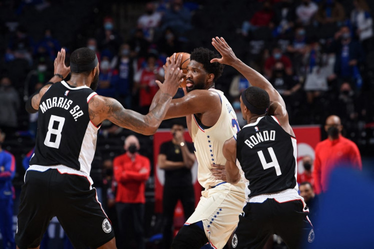 Embiid dominates as Sixers beat Clippers, Utah rallies without Mitchell