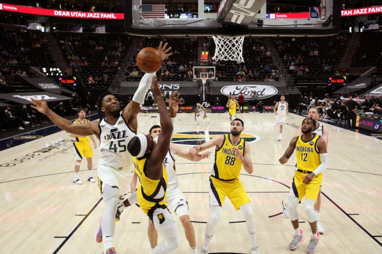 Donovan Mitchell #45 of the Utah Jazz reaches for a rebound during the game against the Indiana Pacers on April 16, 2021 at vivint.SmartHome Arena in Salt Lake City, Utah.