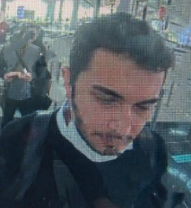 A screen grab made from a CCTV released by Demiroren News Agency on April 22,2021 shows Thodex founder Faruk Fatih Ozer on passport control at Istanbul international airport. Turkish prosecutors on April 22, 2021, opened an investigation after the Istanbul-based founder of a cryptocurrency exchange shut down his site and fled the country with a reported $2 billion in investors' assets.The Thodex website went dark after posting a mysterious message saying it was suspending trading for five days on April 21, because of an unspecified outside investment.