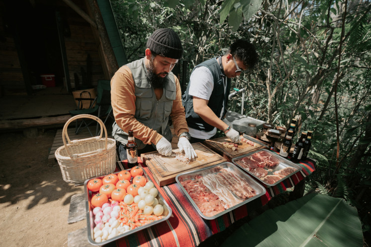 Mouth-watering: Gianjar and Hedi prepare their famous barbecue.