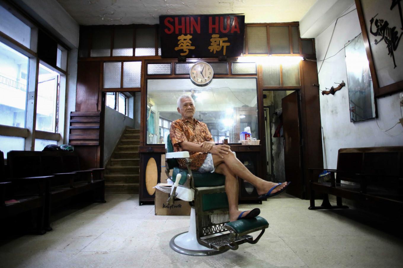 The passion and struggles of Shin Hua, Surabaya's oldest barbershop