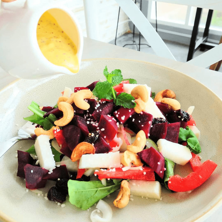 Public favorite: Tanasurga's signature beet salad is made with red beets, peppers, cashews, arugula, onions, jicama, raisins and passion fruit, topped with a homemade passion fruit vinaigrette.